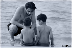 DAD's the world (Sh@dows) Tags: beach boys childhood kids canon photo dad shadows candid father uae son abudhabi advice bwphotography advise twoboys shdows sarin sigma18200mm daddyandboys fatherandkids beachphotography 450d canon450d sarinsoman    nizhal      dadstheworld everlastingadvises