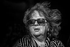 Windswept (Frank Fullard) Tags: frankfullard fullard wind windswept weather gale hair sunglasses glasses spectacles mono blaclandwhite candid street portrait stripes