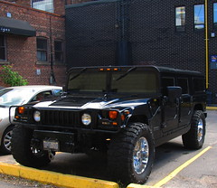 Alpha (Billy Wilson Photography) Tags: ontario canada black monster digital canon toy big cool doors offroad military parking wheels transport mirrors chrome transportation vehicle parked alpha soo northern suv hummer h1 saultstemarie intimidating northernontario algoma polution offroader windsheild chromewheels hummerh1 billywilson hummerh1alpha bigblackmonster