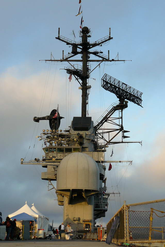 "The command ""Island"" rises above the Hornet's flight deck"