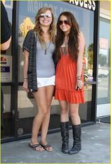 Miley Cyrus and Tish Shopping sunday (Life is a climb <3) Tags: sunglasses fulllength rings bracelets handbag kneehighboots blackboots orangedress mileycyrus