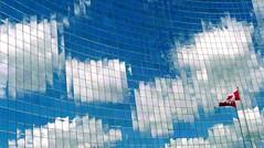 Canadian digital heaven (TheFutureIsUnwritten) Tags: sky toronto canada reflection building glass clouds composition flag universityavenue abigfave platinumheartaward platinumpeaceaward intactbuilding