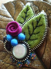 A wee rosy rose (woolly  fabulous) Tags: green wool pin recycled buttons brooch felt zipper embroidered ecofriendly