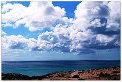 Tra Cielo, Terra e Oceano... Between Sky, Earth & Ocean.. (Claudia Gaiotto) Tags: ocean travel blue wild sky white nature colors clouds spain wind dunes fuerteventura islascanarias isolacanaria
