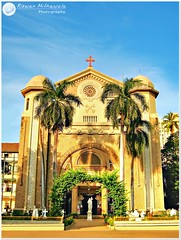 St. Peter's Church, Bandra, Mumbai - India ( Rizwan Mithawala) Tags: camera old blue sea sky people urban sculpture india white color colour heritage church beauty yellow architecture clouds canon temple photography town interesting worship asia photographer village indian religion border landmark structure powershot architect bombay pointandshoot maharashtra finale mumbai romanesque tone hdr compact mws bandra arabiansea rizwan stpeterschurch photomatix tonemapping img0418 intensify a460 canonpowershota460 vanagram rizwanmithawala mithawala wtrmrk ranvarvillage stpeterschurchbandramumbaiindia echenriques