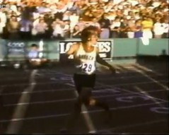 Pre crosses the 5000m final finish line first on July 9, 1972, and looks back to see the jumbotron with his time, 1972 Olympic trials, Hayward Field, Eugene OR (The Happy Rower) Tags: field oregon munich happy university time pirates steve july ducks m eugene final finals pre uo meter hayward olympics 5000 distance runner 1972 trials rower prefontaine 229 5000m thehappyrower thehappyroweryahoocom