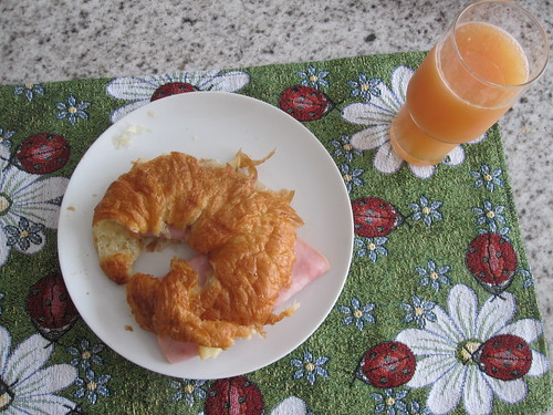 ham and cheese croissant with grapefruit juice