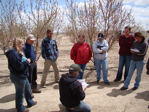Rudy Garcia conducts field training during the Sustainable Agriculture Workshop to area farmers at the Deni' Orchard on the Navajo Indian Reservation in Shiprock, N.M.