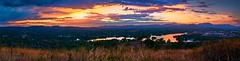 Brooding Sunrise (RobMacPhotography) Tags: landscapes panorama lake mountains tuggeranong canberra act australia sunrise clouds cloudy reflection colourful colours hills suburbs sony a6000 rob mac photography morning water gloomy brooding abcmyphoto