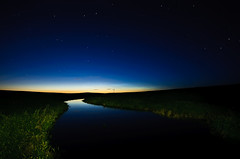 Serenity (David Kingham) Tags: blue sunset orange lightpainting reflection green nature water windmill grass night stars landscape nikon colorado fortcollins astrophotography grasslands pawnee d90 pawneenationalgrasslands pawneegrasslands sigma1020