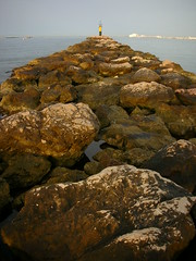 Lighthouse (pdiezvig) Tags: sea roses lighthouse beach faro mar nikon stones playa girona s1 rocas gerona playaderoses