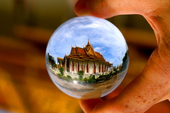The Silver Pagoda, Phnom Penh  Cambodia. Crystal ball (kees straver (will be back online soon friends)) Tags: poverty street travel blue sunset red orange building water architecture children asia cambodia khmer poor sphere torture refraction phnompenh phnom crystalball s21 tuolsleng phnonpenh silverpagoda abigfave earthasia keesstraver