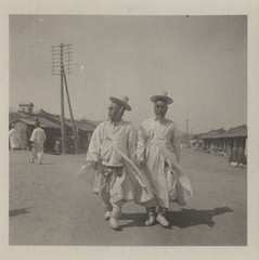 [Korean men with sunglasses] (Cornell University Library) Tags: men sunglasses costume traditionaldress cityviews wallets upperclass utilitypoles cornelluniversitylibrary culidentifier:lunafield=identifier culidentifier:value=1260620804