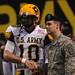 Spec. David Hutchinson of the Army Reserve shakes hands with Connor Wood from Second Baptist High School in Houston, before the start of the U.S. Army All American Bowl game at the Alamodome here Jan. 9.