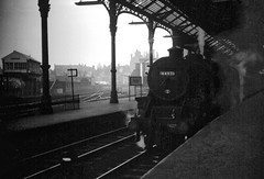 Preston Station Lancashire 9th June 1968 (loose_grip_99) Tags: preston lancashire england northwest station railway railroad rail wcml blackwhite noiretblanc train steam engine locomotive lms stanier black5 460 44971 signalbox docks branch roof trainshed gassteam uksteam endofsteam britishrailways britishrail br transportation shadows june 1968 halina 35x