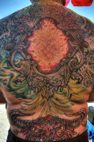 Full back tattoo on biker with demon
