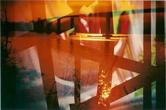 Bridge (jasminfish) Tags: bridge brazil cats colors brasil boats island lomo lomography barcos mask ponte es ilha wrecked máscara vilavelha colorido lomografia gambiarra 3ponte experiência morrodomoreno redscale fujisuperiaiso100 praiadoribeiro muitascores holga135bc