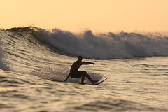 Clint (Diane Rabin) Tags: ocean sunset water indonesia surf rusty wave surfboard sunsetsurf