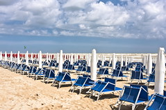Empty Beach (.Gianluca) Tags: trip travel blue red sea vacation sky italy cloud white holiday seascape beach sport clouds umbrella canon seaside bluesky senigallia beachumbrella 40d canon40d