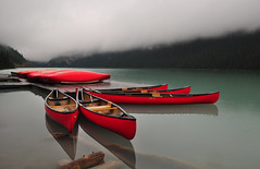 The Fleet of Red Canoes (Bill Gracey) Tags: red vacation lake water reflections explore canoes lakelouise banffnationalpark canadianrockies helluva cloudyweather explored flickrsbest abigfave platinumphoto ultimateshot theunforgettablepictures platinumheartaward goldstaraward tup2 saariysqualitypictures bestofmywinners blinksuperstars