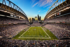 Stadium City (Surrealize) Tags: seattle city sunset game sports field clouds lights washington football athletic team nikon open skyscrapers angle stadium air nfl crowd wide player event jersey poles fans upright hdr scoreboard qwest pigskin endzone 14mm nationalfootballleague d700 seahwawks surrealize