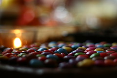 Taste the rainbow (Hajar*) Tags: birthday light food cake canon festive eos 50mm rainbow candle colours bokeh chocolate celebration indoors flame smarties
