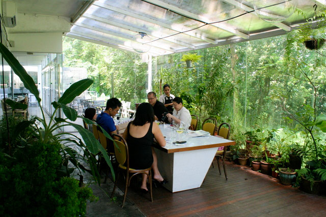The Greenhouse, a lush, glass-encased private dining area