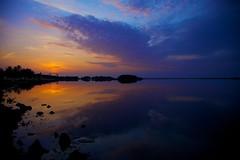 Vibrant Skies (Kausthub) Tags: sky sun india water clouds sunrise handheld dslr 2009 efllens platinumphoto canoneos5dmarkii