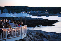 fancy dining on the northshore (lively.lady) Tags: ocean sunset people white lights rocks dining umbrellas challengeyouwinner thechallengefactory