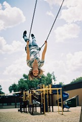 flying (JoshCollins!) Tags: school sky up playground clouds fun fly slide down swing upside
