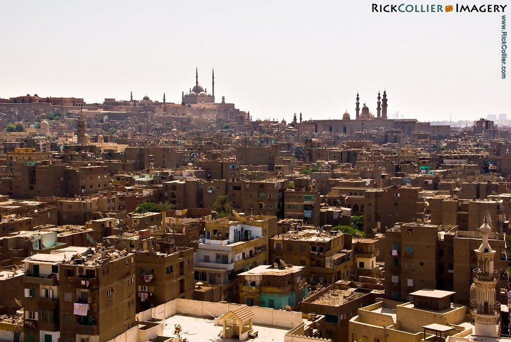 The Citadel of Saladin and Sultan Hassan Mosque and Madrasa dominate the skyline, above the rooftops of old Islamic Cairo