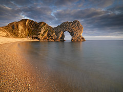 Durdle Door (peterspencer49) Tags: ocean door uk sea england seascape southwest beach sunrise coast waves arch unitedkingdom steps pebbles unesco dorset stunning oceanview seaview seamist westcountry southwestcoast lulworthcove durdledoor stonearch rockarch southwestcoastalpath woldheritagesite stunningview manowarbay oceanveiw limestonearch stunningseascape