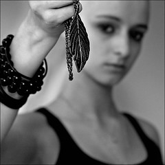 Talisman (Laura Galley) Tags: portrait blackandwhite bw woman blur art girl teenager ourtime 500x500 goldenart dragondaggerphoto lauragalley masquemilpalabras lgphotoart
