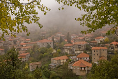 village in fog (Thalia Nouarou) Tags: winter fall greece arkadia peloponnese nikond60       thalianouarou   wwwthalianouarouwebscom wwwepathlogr