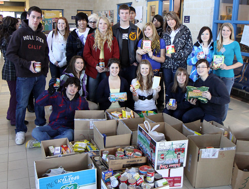 DHS Leadership pose with the results of the annual DHS food drive.
