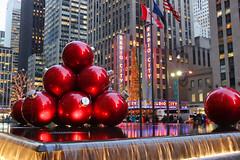 Radio City Xmas Ornaments (NjCarGuy) Tags: christmas new york xmas city nyc red music holiday tree water radio canon giant season hall waterfall balls ornaments feature topaz adjust cs4 yearofholidays