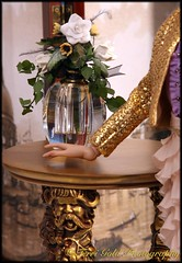 Doll Still Life with Hand (Terri-NY) Tags: stilllife floral table gold hand gargoyle vase antoinette cami sequin