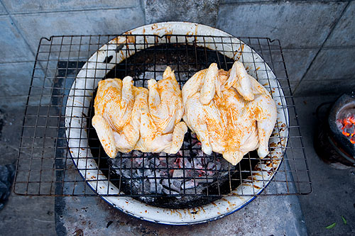 Portuguese-style chicken ready to be grilled on the streets of BKK