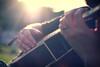 guitar playing hands (ginnerobot) Tags: light summer music sun outside 50mm hands backyard bokeh guitar jonathan july naturallight listening acoustic sunflare acousticguitar playingmusic