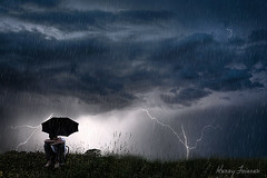 storm of life (heaven_bound) Tags: portrait storm field rain clouds umbrella self lightning