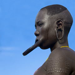 Mursi woman with lip plate Omo Valley Ethiopia (Eric Lafforgue) Tags: africa travel ladies portrait people woman girl face lady dam couleurs tribal lips adventure human clay blackpeople ethiopia tribe ethnic barrage bodymodification gens visage labret ethnicity afrique tribu omo eastafrica thiopien etiopia abyssinia ethiopie etiopa blackskin labrets colorpicture ethnique abyssinie  etiopija ethnie ethiopi  lipplug lipplate photocouleur etiopien etipia  etiyopya  afriquedelest lipplates colourpicture    salinicostruttori    humainpersonne plateaulabial gibeiiidam gibe3dam bienvenuedansmatribu peoplesoftheomovalley lipdisclipplate piercedhole piercedlipornament