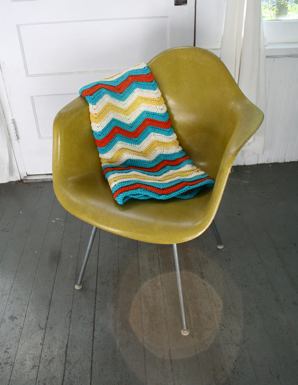 This shell chair is much improved with an awesome ripple blanket