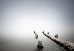 Infinite Salton (Jeff Engelhardt) Tags: sea monochrome fog canon landscape long exposure infinity piers salt smooth apocalypse experiment tint pilings vignette tone 1022mm infinite salton selenium 40d