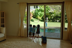 3 year olds watching Ah Gong get the pool ready for them