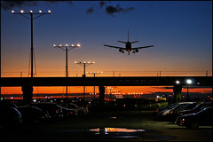 plane sunset (Dan Anderson (dead camera, RIP)) Tags: pink blue sunset red sky orange silhouette yellow night clouds plane lights evening airport parkinglot aircraft jet landing bluehour magichour sirport artofimages bestcapturesaoi luxtop100 dvamflickrexperiment