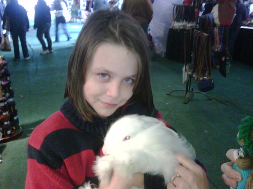 Child with her Angora rabbit
