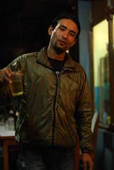 Nepali trek guide (Radosaw Kut) Tags: travel nepal portrait man beer night trek view guide annapurna nepali