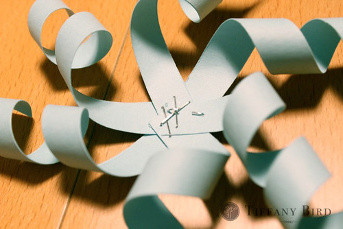 twirly snowflake stapled