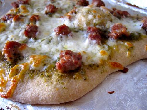finished product: pesto sausage pizza