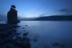 Siwash Rock in blue... (Claire Chao) Tags: ocean longexposure blue sunset sea canada rock vancouver canon spring lowlight rocks mood alone bc waterfront britishcolumbia bluewater may bluesky seawall stanleypark siwashrock hue springtime bluehue aftersunset longexposures llens customwb beautifulbritishcolumbia inblue treeontherock 1635mmf28 canoneos5dmarkii darkrocks 3800k0 seawallpathway